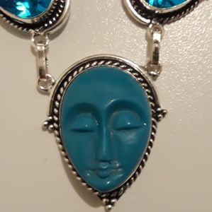 Blue carved face necklace and earring set